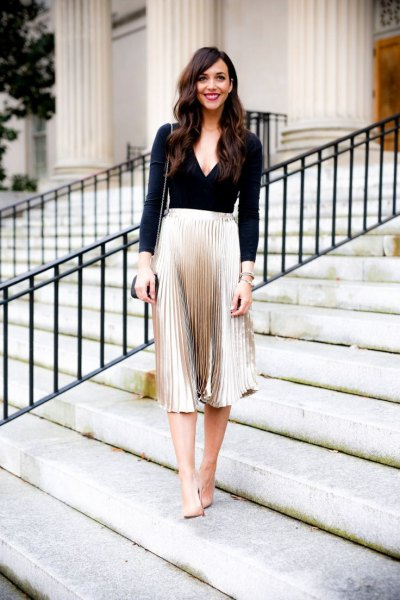 black deep v neck long sleeve top silver metallic midi pleated skirt