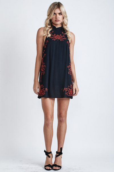 black halter neck mini shift dress red embroidered details