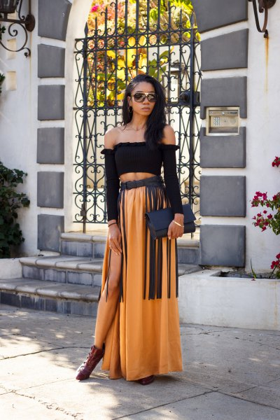 black off the shoulder top and gold maxi skirt