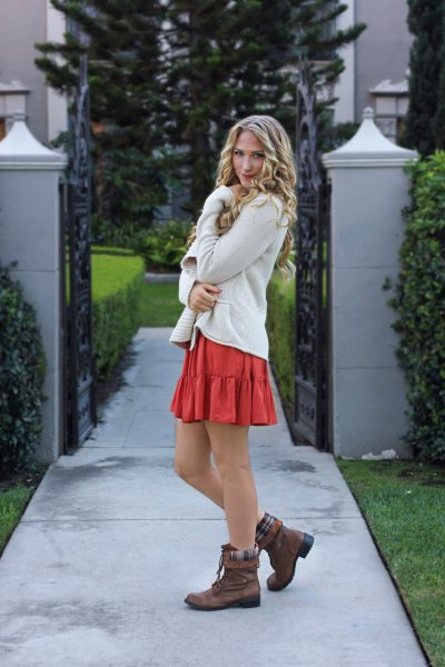 brown fold over boots white cardigan orange mini skirt