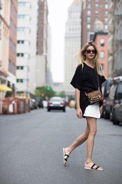 gold slide sandals with black tee white skirt