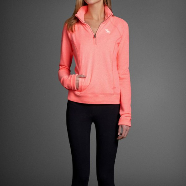neon pink pullover black skinny jeans