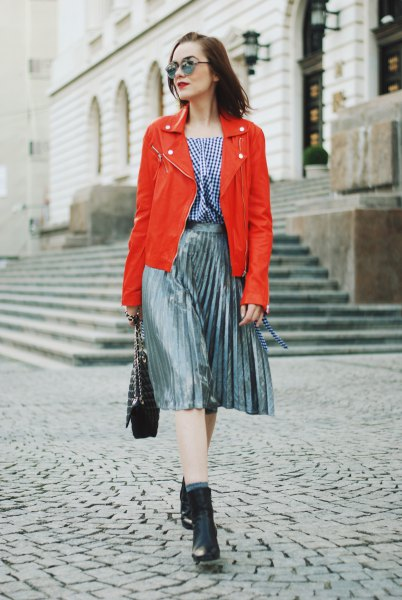 orange leather jacket silver pleated midi skirt