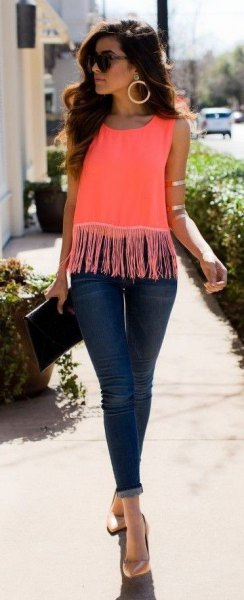 pink fringe top dark blue skinny jeans