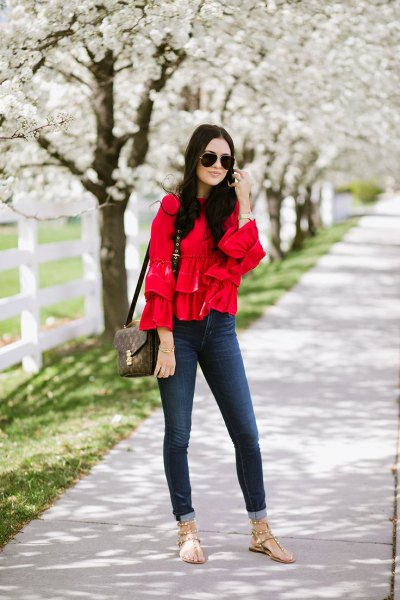 red ruffle blouse cuffed skinny jeans