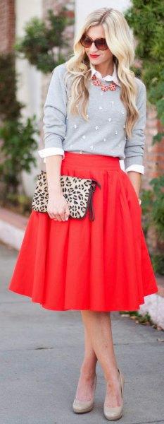 red skirt grey sweater cheetah bag