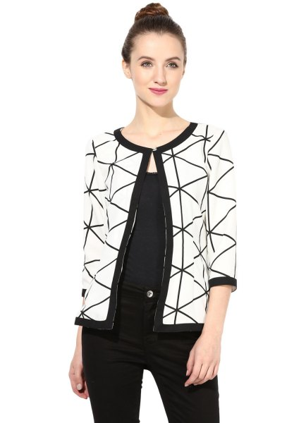 white and black printed shrug with vest top jeans