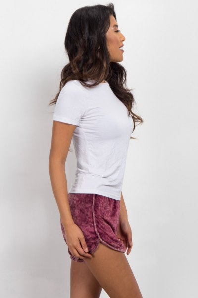 white form fitting t shirt pink shorts