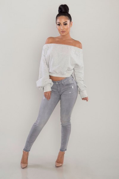 white off shoulder cropped sweatshirt grey skinny jeans
