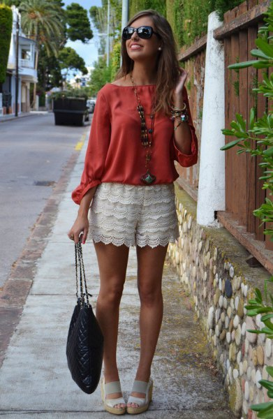 white shorts red boat neck buttonless blouse