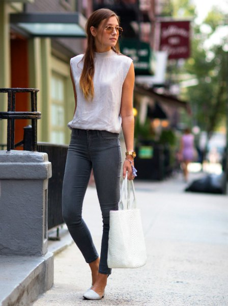 white sleeveless mock neck blouse grey skinny ankle jeans