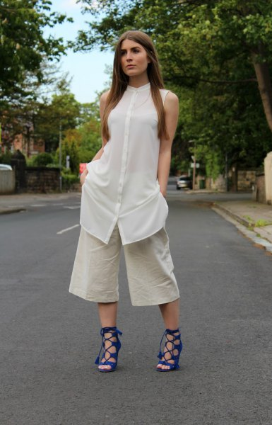 white sleeveless shirt dress over pale pink wide leg cropped pants