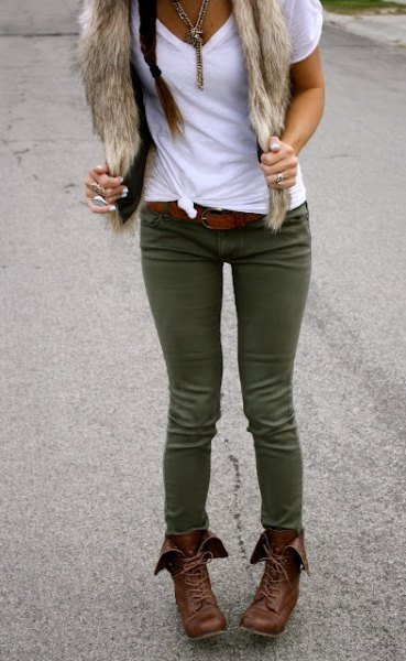 white t shirt green skinny jeans