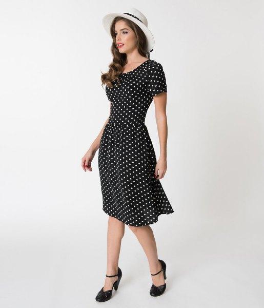 black and white polka dot swing dress with white felt hat