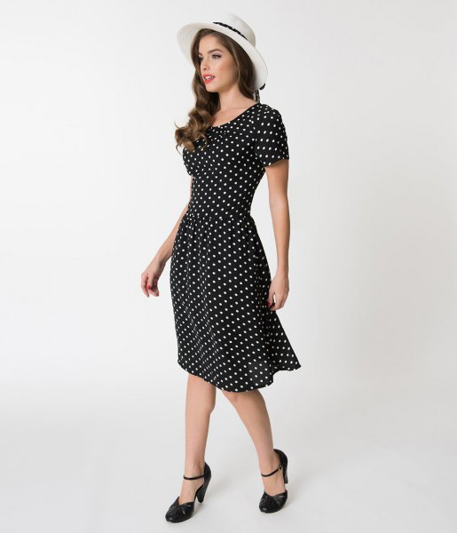 black and white polka dot swing dress with white felt hat