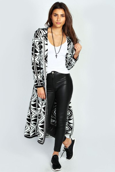 black and white printed hooded cardigan and leather leggings