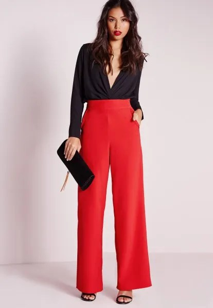 black deep v neck blouse with red high waisted wide leg trousers