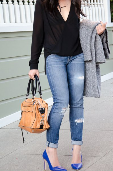 black deep v neck wrap blouse with cuffed skinny jeans