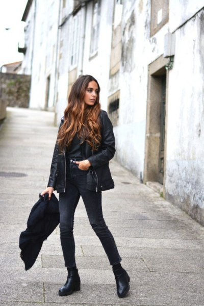 black leather coat with button up shirt and skinny jeans
