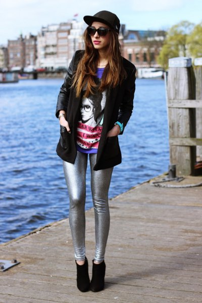 black leather jacket with blue print tee silver leggings