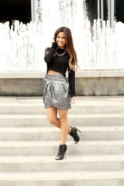black long sleeve crop top with silver mini skirt