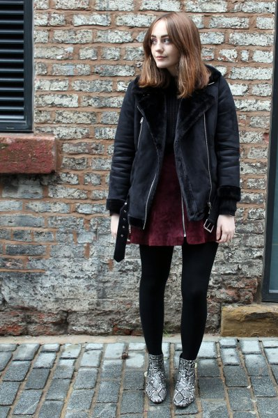 black shearling jacket with dark green suede mini dress