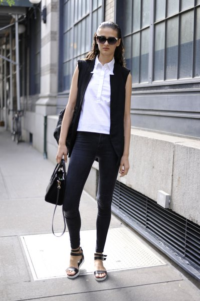 black sleeveless blazer with white sleeveless button up shirt