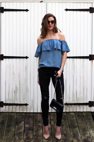blue denim off the shoulder top with black skinny jeans