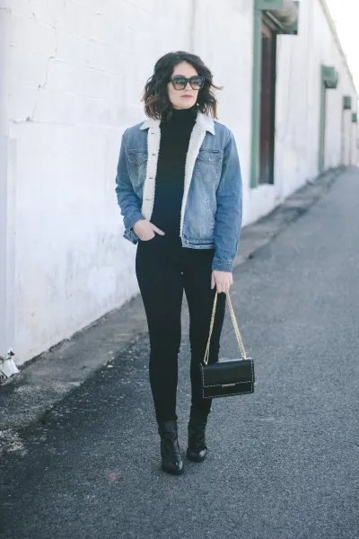 blue denim sherpa lined jacket with all black outfit