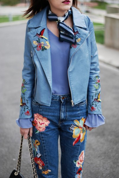 blue embroidered leather jacket with silk scarf jeans