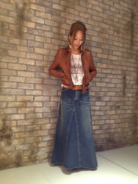 blue slightly flared maxi denim skirt with brown leather jacket