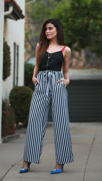 camisole with black and white striped high waisted trousers