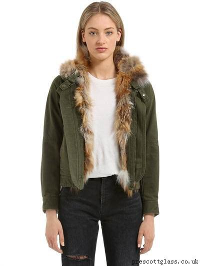 fur lined green denim jacket with black ripped jeans