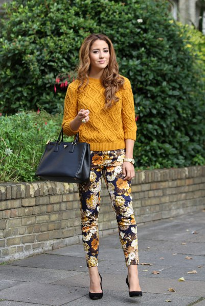 green cable knit sweater with black floral pants