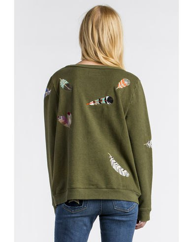green cartoon embroidered sweatshirt with matching skinny jeans