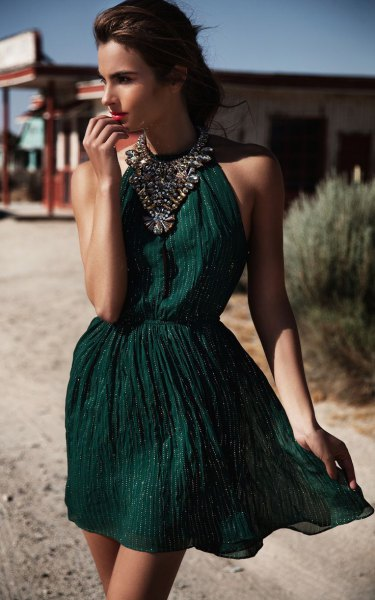 green halter gathered waist mini cocktail dress with statement necklace