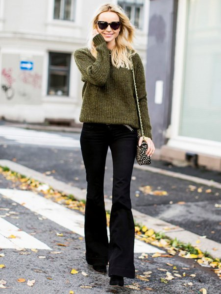 green ribbed knit sweater with black flared pants