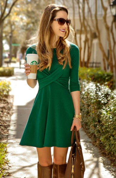 green three quarter sleeve skater cocktail dress with knee high boots