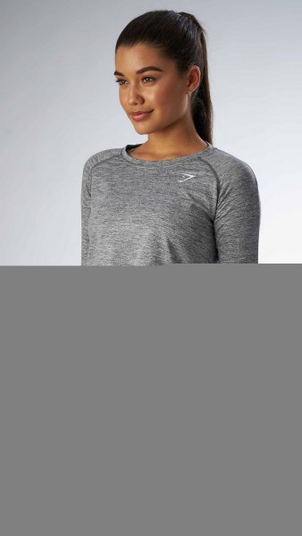 grey long sleeve cropped tee black running tights