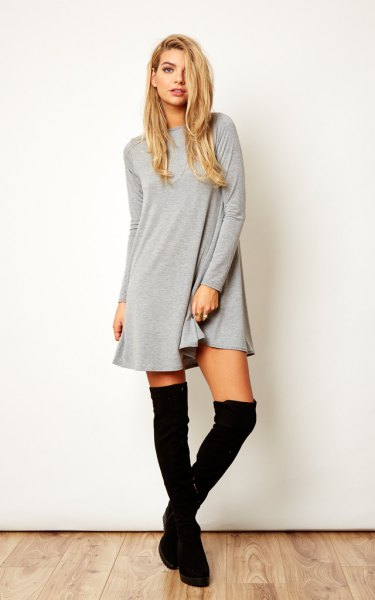grey long sleeve swing dress with black thigh high boots