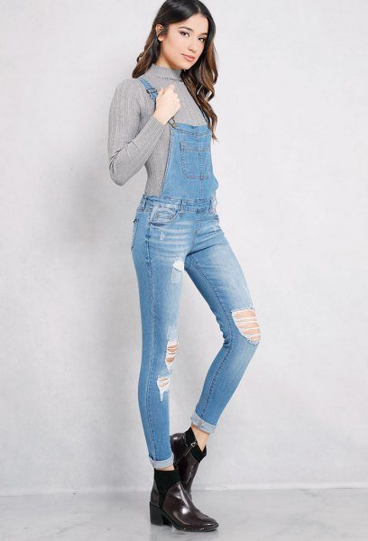 grey mock neck ribbed sweater with ripped skinny denim overall