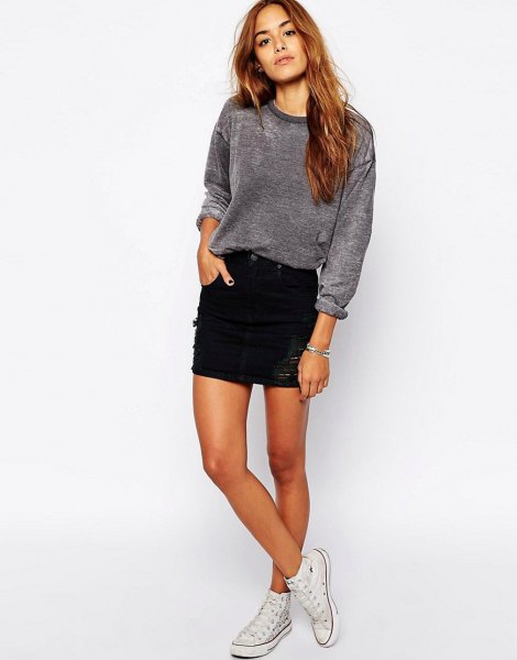 grey velvet sweatshirt with black denim skirt