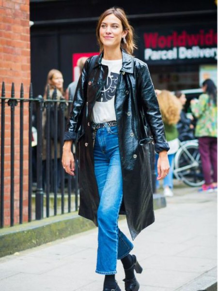 long black leather coat with white print tee and ankle jeans