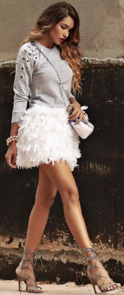 pink embroidered sweatshirt with white feather skirt