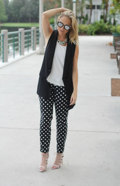 polka dot pants with white sleeveless top black vest