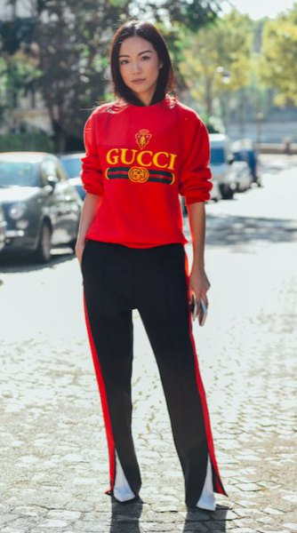 red sweatshirt with black running pants