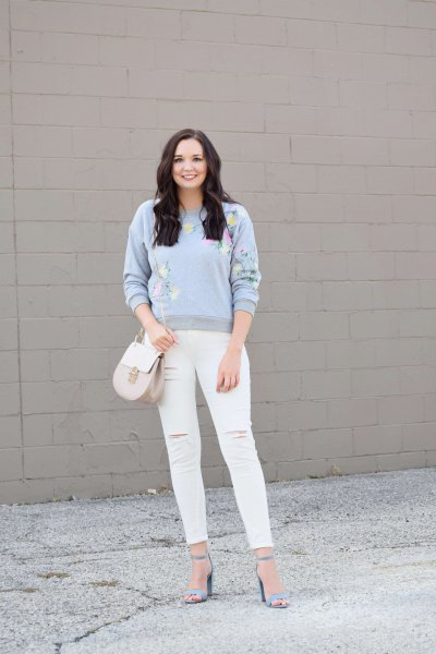 sky blue sweater with white ripped skinny jeans
