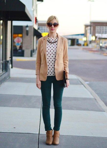 white and black polka dot blouse dark grey skinny jeans