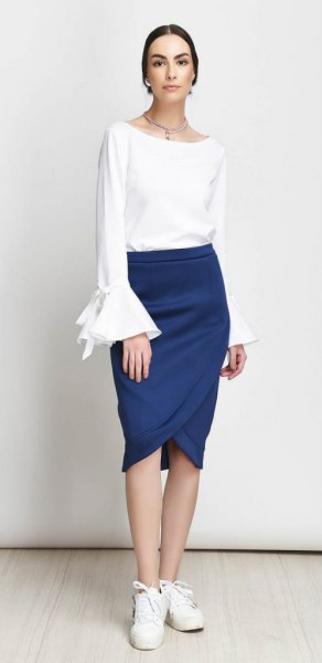 white bell sleeve top with dark blue tulip skirt