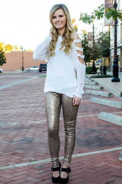 white boat neck cut out sweater with gold sequin leggings